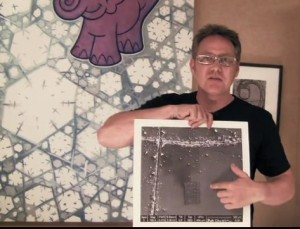 Robert Chaplin with an enlarged image of his nanobook
