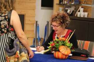 Lorna Crozier signs books at her launch in October