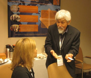 Dr. Ed Ishiguro from the Learning and Teaching Centre at UVic talks with an attendee
