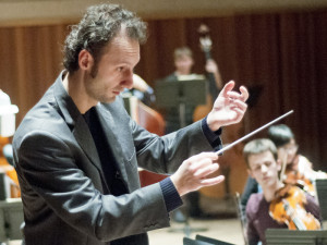 Csaba rehearsing the UVic Orchestra (UVic Photo Services)