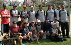 Shoemaker (centre, with bat) and her Iowa Writers' Workshop softball team