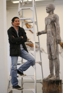 Willie Seo with his paper man (photo: Adrian Lam, Times Colonist)