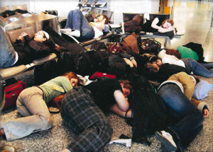 Exhausted refugees? Nope, some of the Chamber Singers at the Moscow airport in 2007
