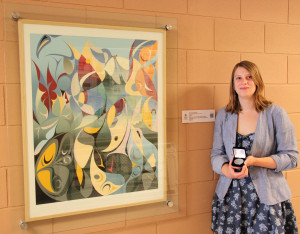 Regan Shrumm with her Victoria Medal and an exmpale of her QR code work in the Salish Reflections collection