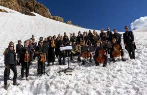 Csaba conducts the Requiem, with the Jumbo glacier in the background (photo: Pat Morrow)