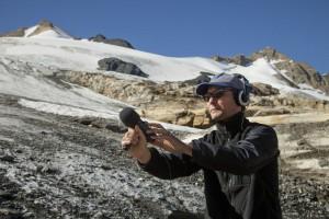 Paul Walde recording on Farnham Glacier (photo: Pat Morrow)