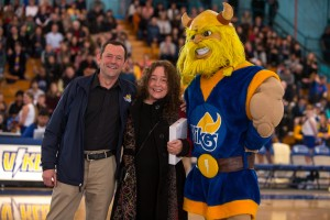 UVic President Jamie Cassels and Vikes mascot Thunder present Rally Song winner Colleen Eccleston with her iPad (photo: Armando Turo)