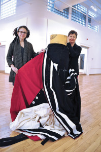 Legacy's Justine Drummond (left) & Caroline Riedel with a small slice of the world's biggest button blanket (photo: Edward Hill/Vic News)