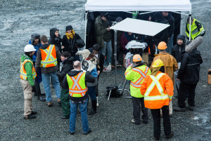 Bradley speaks to actors dressed as construction workers on location (photo: Arnold Lim)