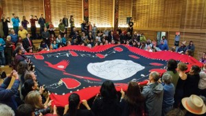 The button blanket receiving its inaugural dance at UVic's First Peoples House (Photo Services)
