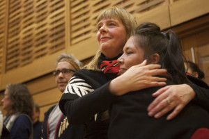 A happy—and no doubt relieved—Carolyn Butler Palmer watches as the big button blanket is raised in First Peoples House (UVic Photo Services)