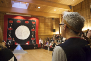 Peter Morin observes the big button blanket after it has been raised in First Peoples House (UVic Photo Services)