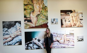 BFA student Heather Carter with her wall of nudes
