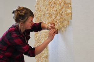 BFA student Marina Eglis installs her piece in the graduating exhibit Split