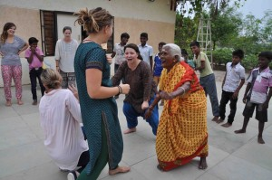 UVic students, Nikki Bell, Aisling Kennedy, & Katelyn Clark, create a 'Happy Machine' with Jayamma & boys from the AIM for SEVA Cuddalore Boys home (photo: Laura Buchan)