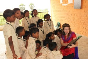 UVic Student Kathleen O'Reilly reads to Isha School Children (photo: Nikki Bell)