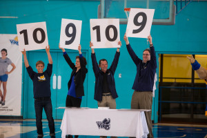 Susan Lewis (second left) declaring the winner in the Vikes Nation Rally Song contest with UVic President Jamie Cassels (second right)