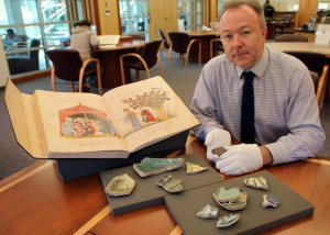 Dr. Marcus Milwright with some of the important Middle Eastern artifacts in Special Collections