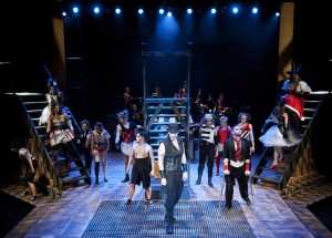 The beggars, prostitutes and down-and-out sing in Phoenix Theatre's production of The Threepenny Opera (photo: David Lowes)