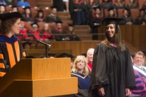 Dr Lewis presiding at Fine Arts convocation in June 2016, with double-medal winner Kelsey Wheatley