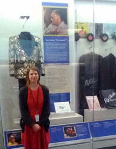 Regan Shrumm at the Smithsonian's Ray Charles display, which she worked on as an intern